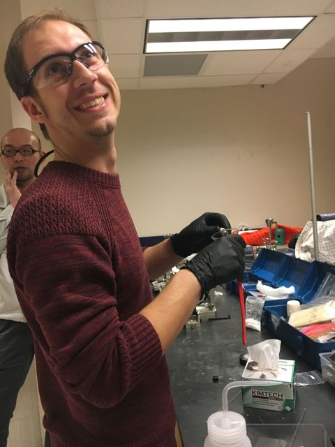 Michael Tarne (of Neilson Lab) making rods for crystal growth.